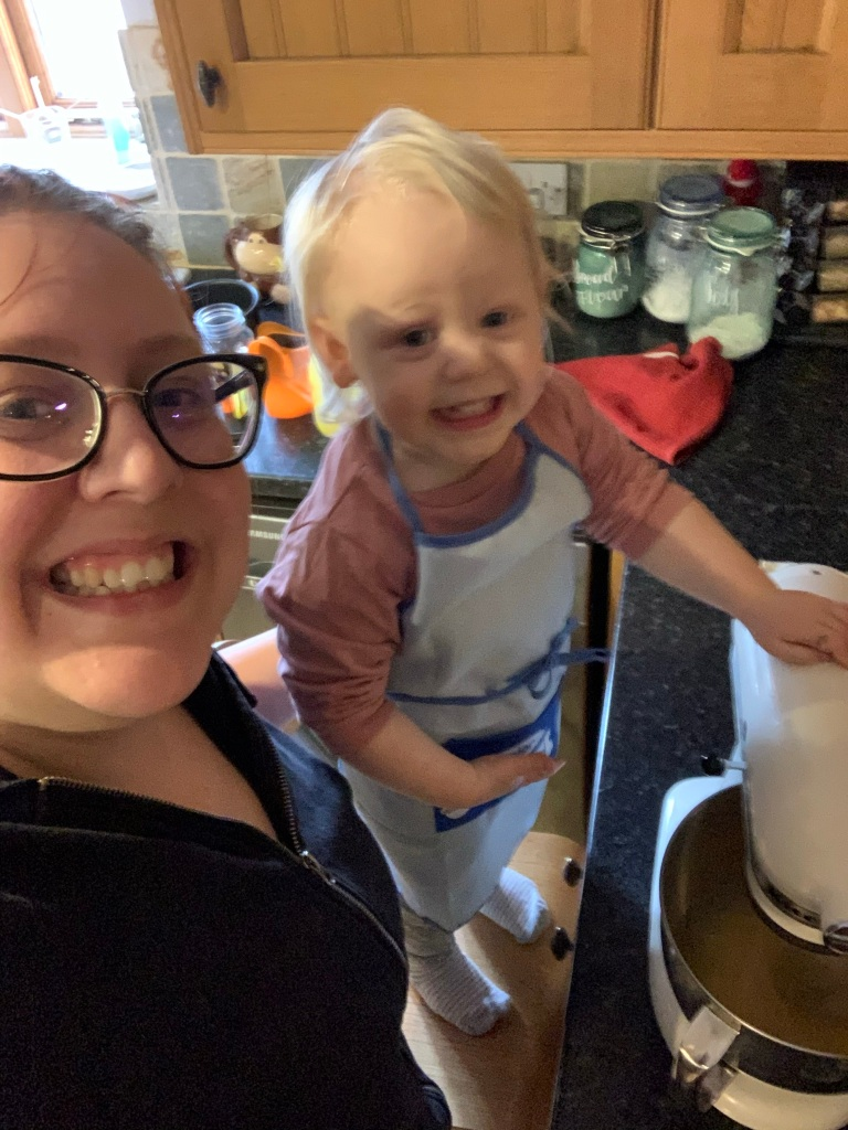 Happy toddler and mum with the Kitchen Aid mixer